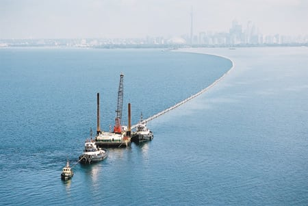 6. Going deep. To build the Deep Lake Water Cooling system, huge intake pipes had to be towed out into Lake Ontario and sunk to a depth of 272 feet, where the water is 39.2F year-round. Courtesy: Krohne Inc.