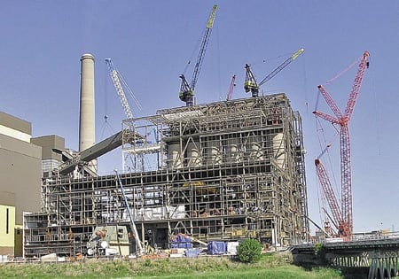 4. Raise the roof. Erection of the boiler and steel frame nearing completion. Courtesy: Hitachi