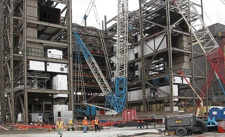 10. Parallel processing. Hitachi has perfected simultaneous erection of structural steel and boiler components. The technique shortens construction schedules. Courtesy: Hitachi America Ltd.