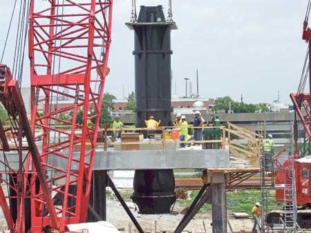 4.Eight is enough, for now. One of the eight 68-inch x 72-inch SAFV mixed-flow pumps being installed at the London Avenue Canal in New Orleans. Courtesy: Patterson Pump Co.