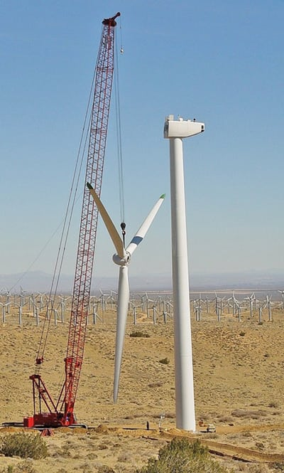 2. Heavy lift. A crane lifts an entire blade assembly into place during construction of the 60-MW Oasis Wind Power Project. The project uses 50 Mitsubishi turbines rated at 1 MW each, and its output is sold to San Diego Gas & Electric Co. Courtesy: Mitsubishi Heavy Industries