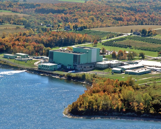 "<strong>New York</strong>. <a href=""https://www.powermag.com/generators-sue-to-block-lifeline-for-new-york-nuclear-plants/""><u>Dynegy and NRG Energy in October 2016 also filed a similar suit</u></a> in federal court seeking to block New York's Clean Energy Standard, <a href=""https://www.powermag.com/n-y-approves-nuclear-subsidies-and-mandates-50-renewables-by-2030/""><u>an incentive program</u></a> approved by the New York Public Service Commission in August 2016 that would use ZECs to help three of that state's nuclear power plants—R.E. Ginna in Ontario, Nine Mile Point in Oswego, and FitzPatrick in Scriba—remain economic over the next decade. The program requires owners of eligible ZECs to enter into long-term contracts with the New York State Energy Research and Development Authority (NYSERDA). Under those contracts, the owners sell the zero-emissions attributes associated with power produced by the plants. Starting in April 2017, New York load-serving entities will be required to buy various amounts of ZECs from NYSERDA each year. <br /> <br /> The measure has been opposed by environmental and citizen groups, which say it would result in a $965 million dollar increase in rates. Supporters of the measure argue—citing a Brattle Group study—that electricity consumers in New York would be subject to about $15 billion of additional electricity costs over the next 12 years if the nuclear plants were to close. However, the plan has been seemingly stalled by the New York General Assembly, which recently added a moratorium to its budget bill suspending implementation of the New York ZEC program through December 2018—or at least until state officials appear before the legislature to explain the PSC's controversial decision to approve the ZECs. <br /> <br /> <em>R.E. Ginna Nuclear Power Plant. Courtesy: Exelon Corp. </em>"
