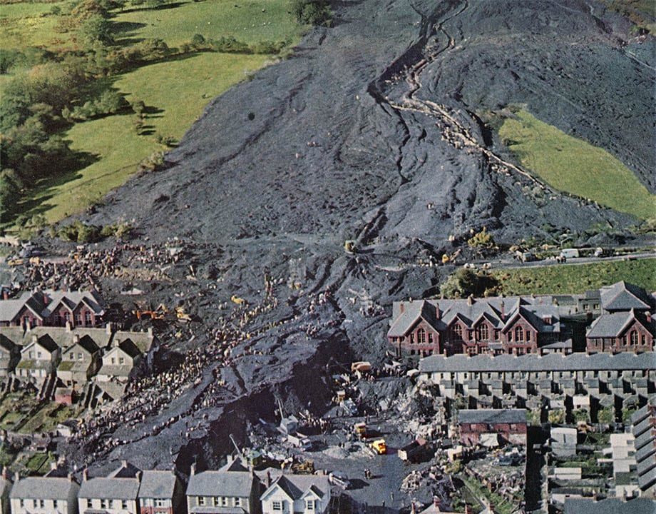 <strong>October 21, 1966—Aberfan, Wales, UK: </strong>The collapse of a dump containing coal mining debris over a Welsh village kills 116 children and 28 adults, many of whom had just started the day at a primary school. <em>Source: Wikimedia Commons </em>
