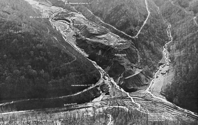 """<strong>February 26, 1972—Logan County, W.Va.: </strong>The failure of the Pittston Coal Co.'s coal slurry impoundment dam #3 unleashes a flood of black wastewater, killing 125 people, and injuring 1,121. The incident happens four days after the dam had been declared """"satisfactory"""" by a federal mine inspector. <em>Source: Wikimedia Commons </em>"""