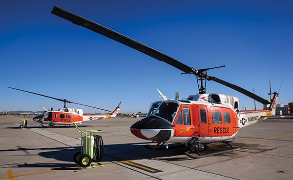 """Two HH-1N """"Huey"""" helicopters sit on the grounds outside of the Search and Rescue hangar aboard Marine Corps Air Station Yuma, Ariz., Friday, Feb. 12, 2016. The MCAS Yuma SAR team hosted a conference with regional emergency services personnel to discuss tactics, techniques and procedures."""