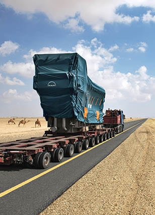 MAN Diesel & Turbo engine transported through the desert of Saudi Arabia.
