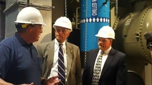 Mike Henderson (left), Director of Plant Operations Trenton for Veolia North America, talks with Richard Mroz (middle), president of the Board of Public Utilities for the state of New Jersey, and Bill Golubinski, manager of energy initiatives for the state, during a tour of Veolia's Trenton Thermal Energy thing.