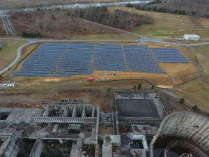 A new 1-MW solar power farm has begun operating on the site of the abandoned Phipps Bend nuclear power plant project. The TVA canceled the nuclear project in 1981. The remnants of a cooling tower are visible at lower right. Courtesy: United Renewable Energy
