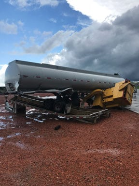 Outside the Transmission System Maintenance shop near Dry Fork Station, workers found a tanker semi-trailer on top of a wood chipper, which was on top of a flatbed trailer. Four tornadoes touched down in Campbell County, Wyoming, on June 1. Courtesy: Basin Electric