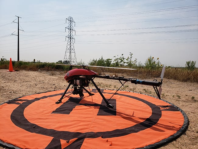 Xcel Energy is the first U.S. utility to operate drones beyond visual line of sight during ongoing inspections of transmission lines. (Photo: Xcel Energy)